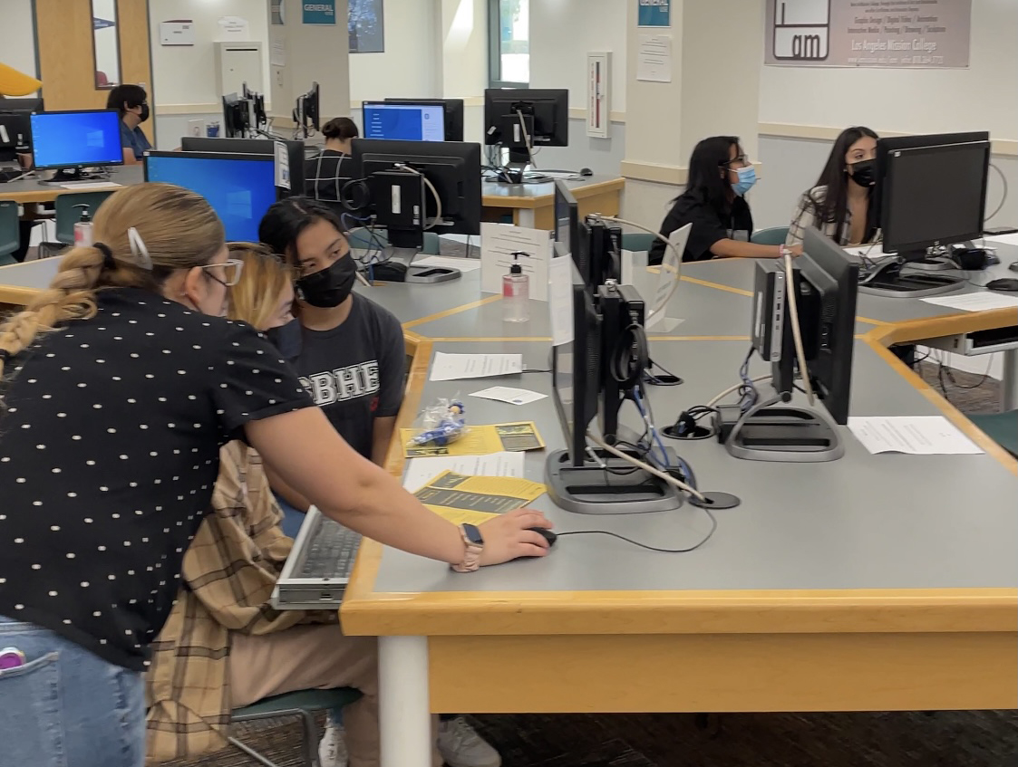 Students get help registering for classes in the Learning Resource Center.