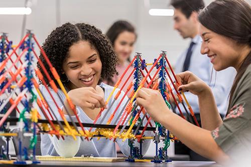 Engineering Students Building Bridge