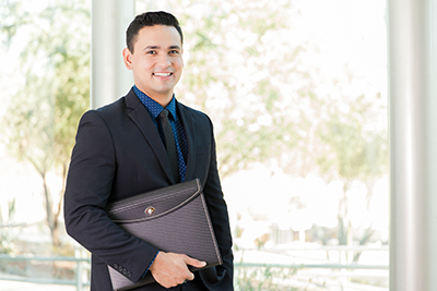Latino job applicant holding portfolio