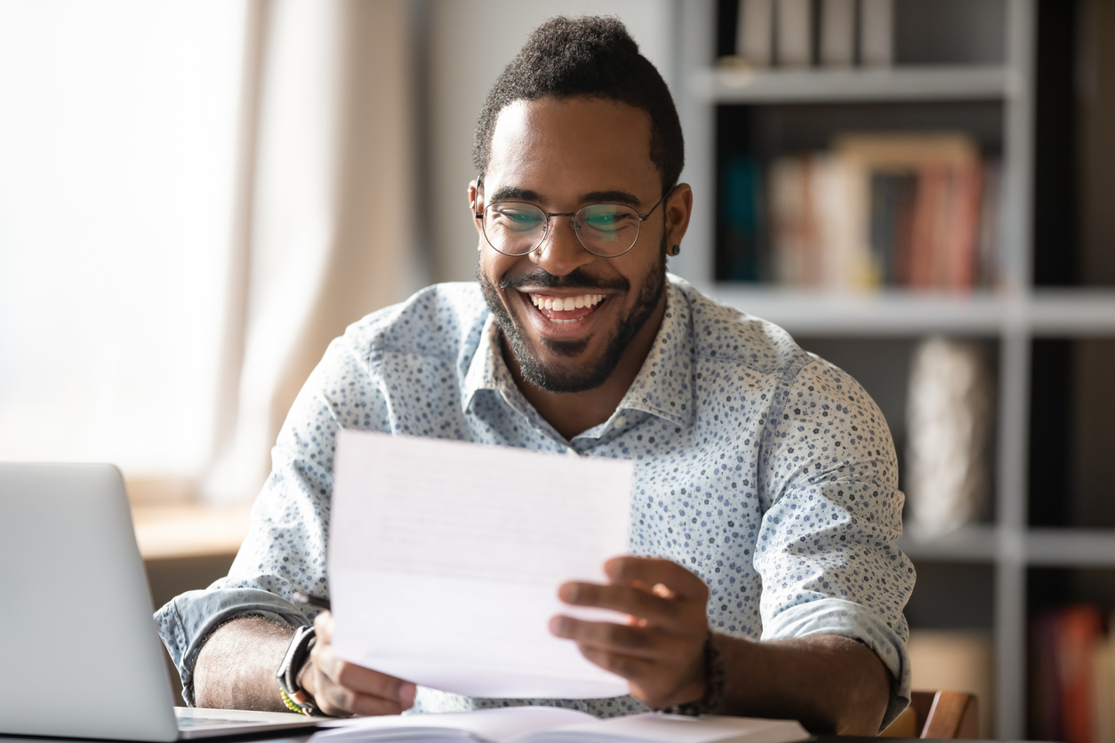 African American student reading letter with good news