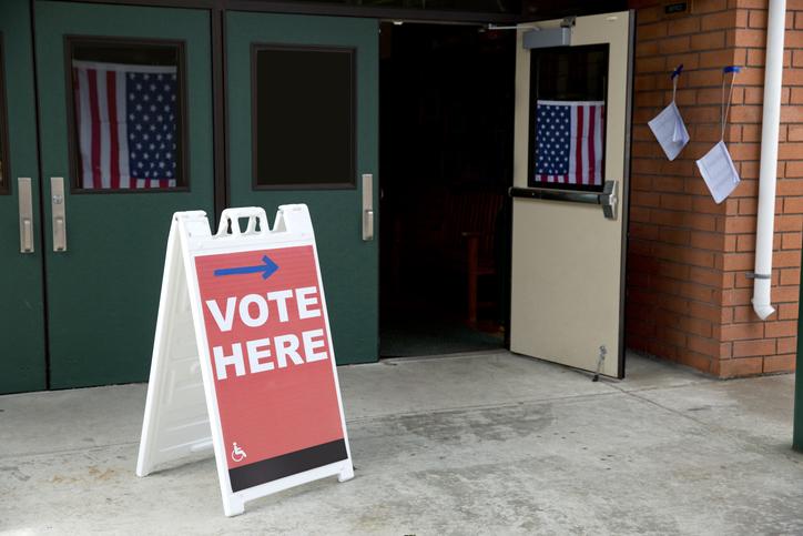 Vote Here Sign Near Door