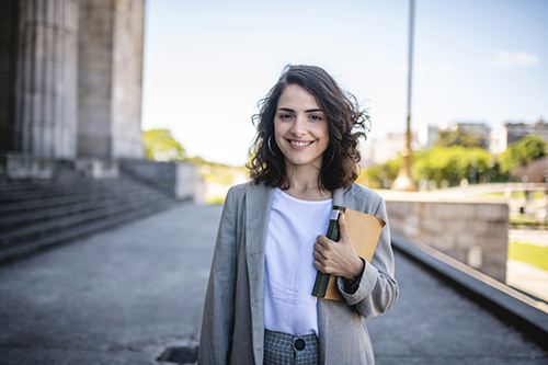 female law student holds a book